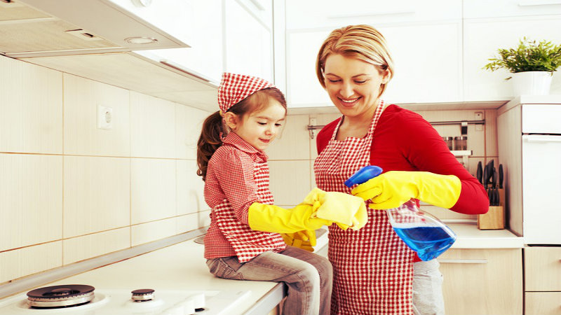 a woman with her daughter inside a kitchen