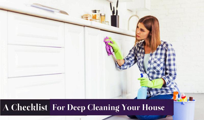 beautiful woman wiping kitchen cabinets