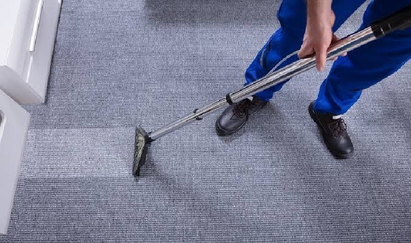 young professional wiping a carpet