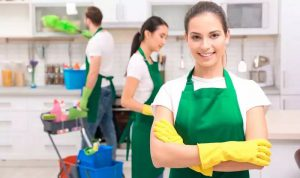 group of professional with green apron making a kitchen tidy