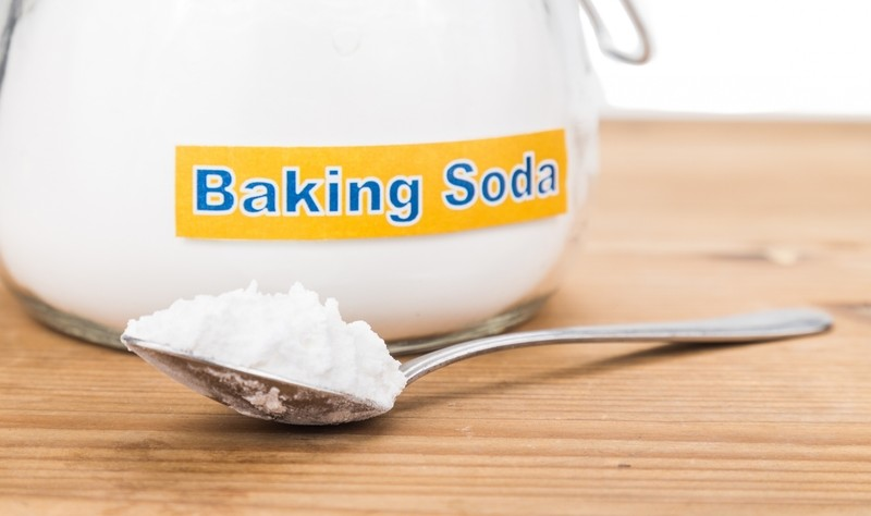 a bowl and a spoon full of baking soda