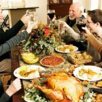 entire family enjoying thanksgiving dinner party