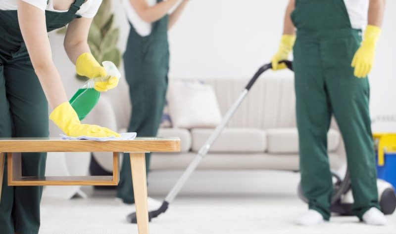 group of professional cleaners sprucing up a property