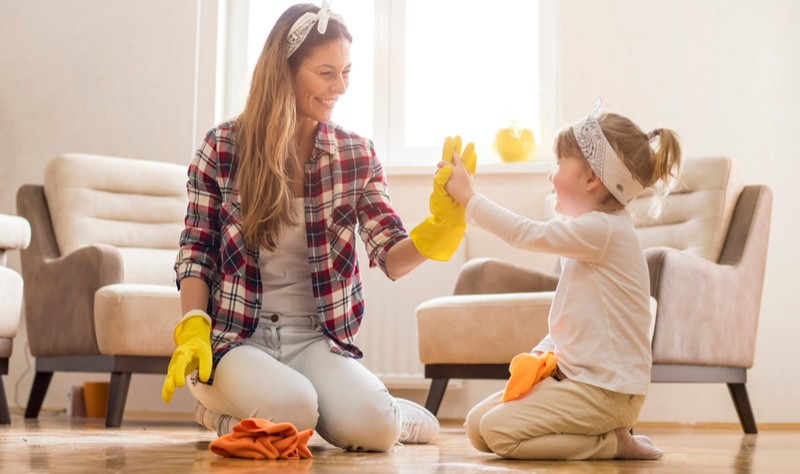 young woman is sprucing up her house with her daughter