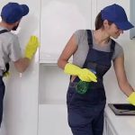 professional cleaners sprucing up a kitchen