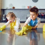 young kids sprucing up a kitchen